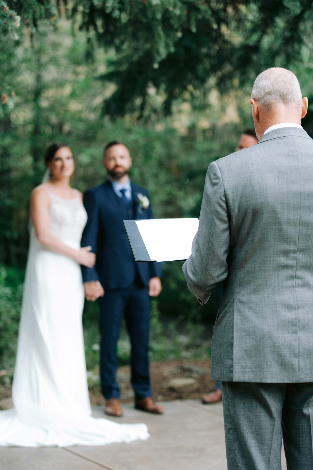 Casey Andrew Wedding Ceremony Couple and Officiant