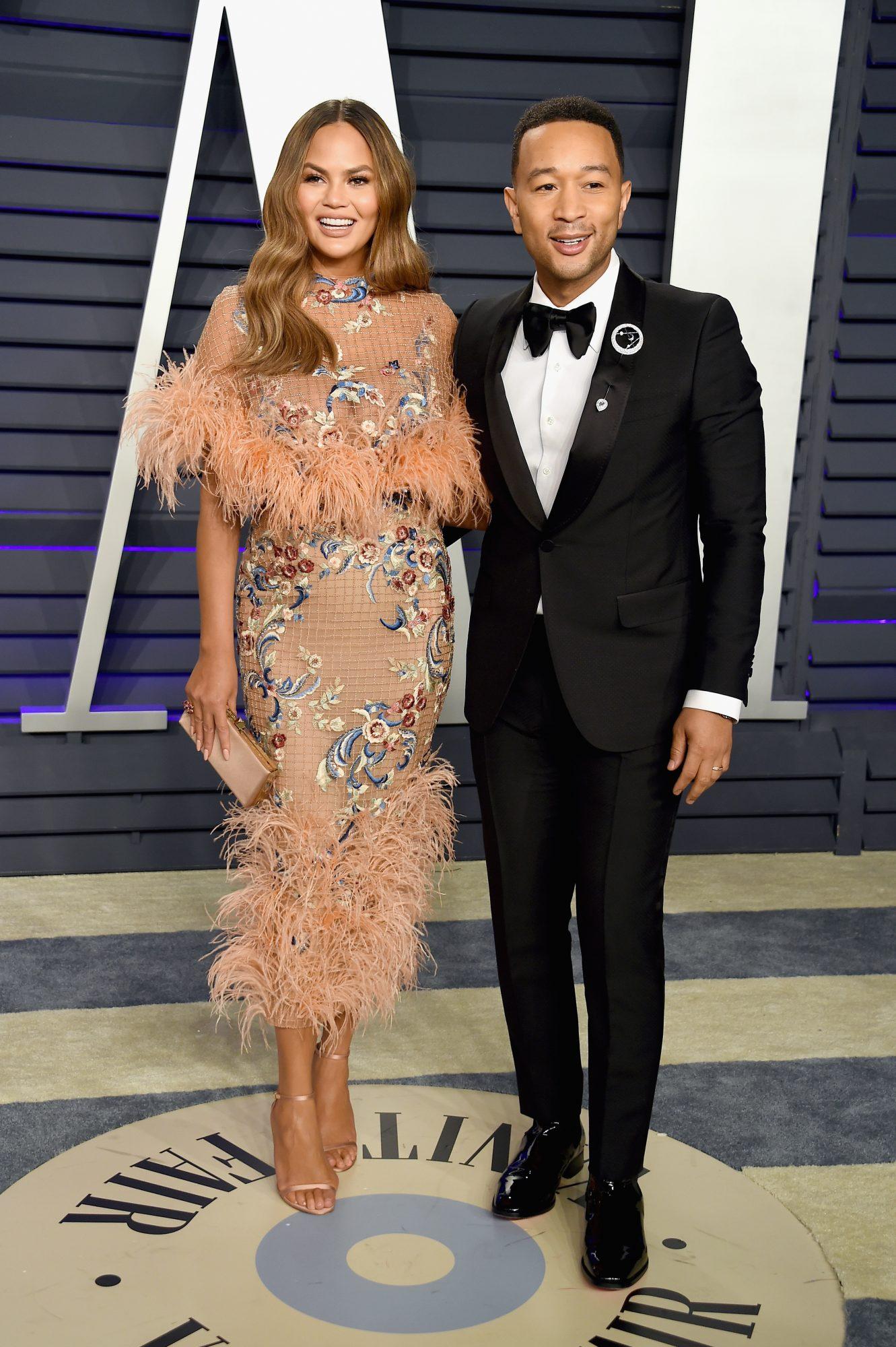 Chrissy Teigen and John Legend on the red carpet.