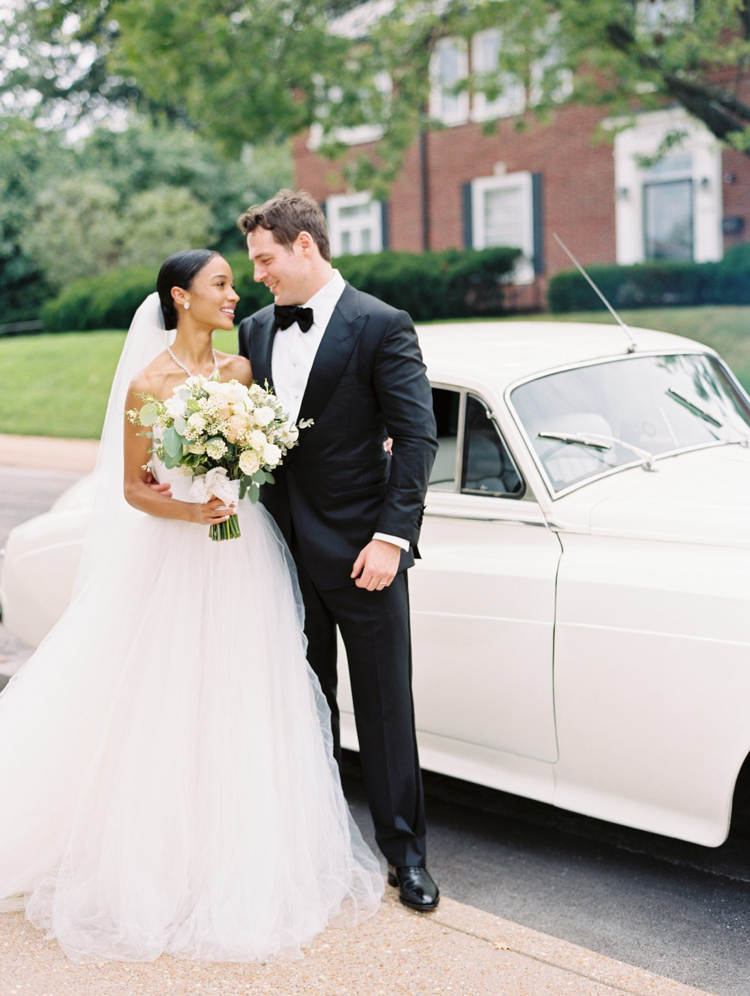 erinn andrew wedding couple pose by vintage car