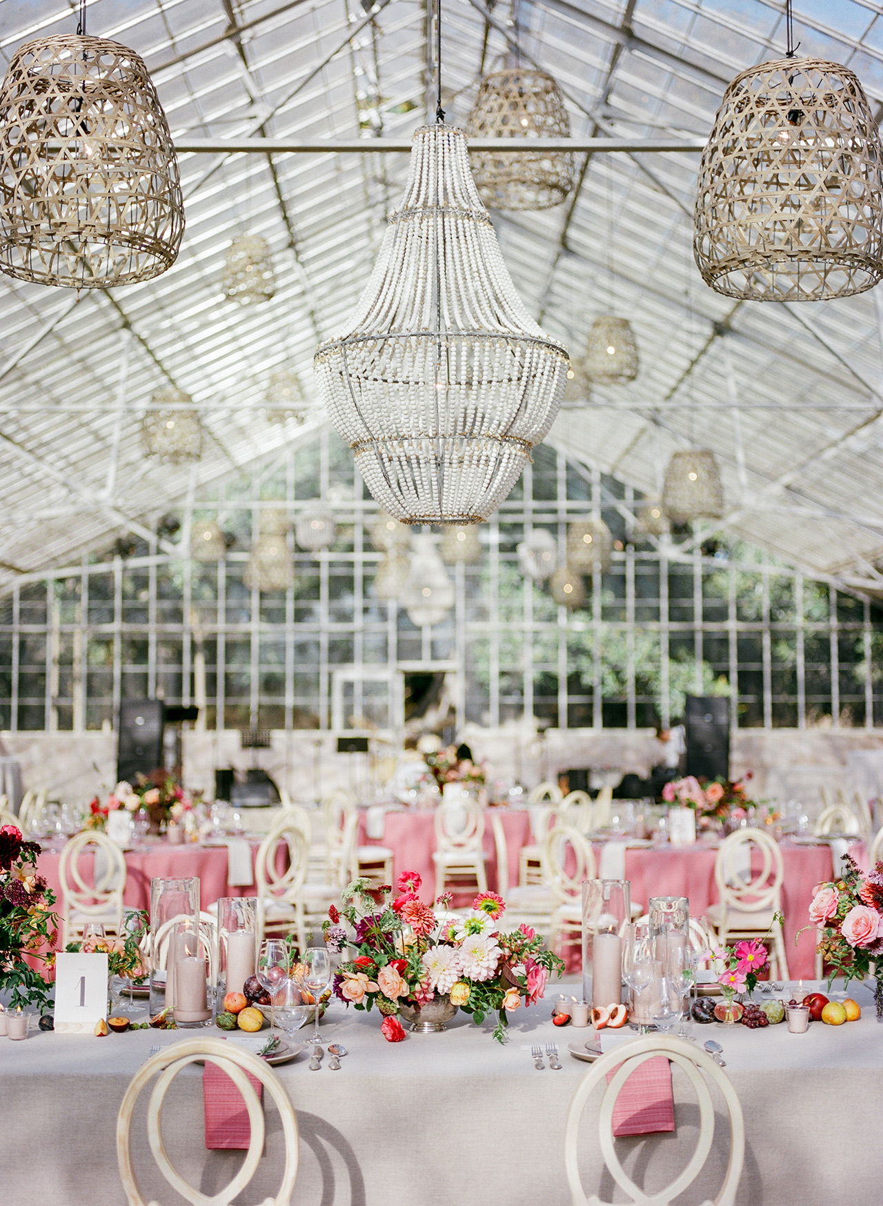 wedding reception greenhouse space greige chandeliers