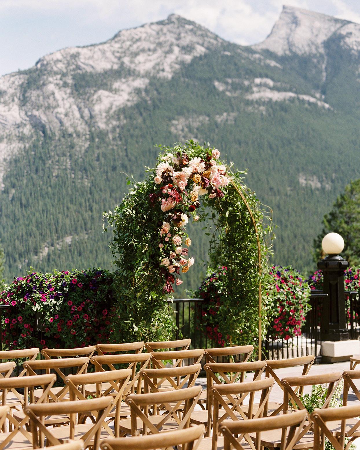 katie nicholas wedding arch with mountain backdrop