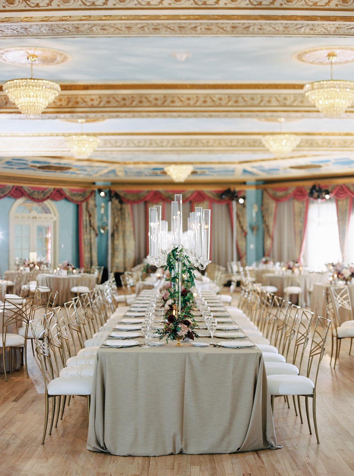 katie nicholas wedding reception elegant long tables in ballroom