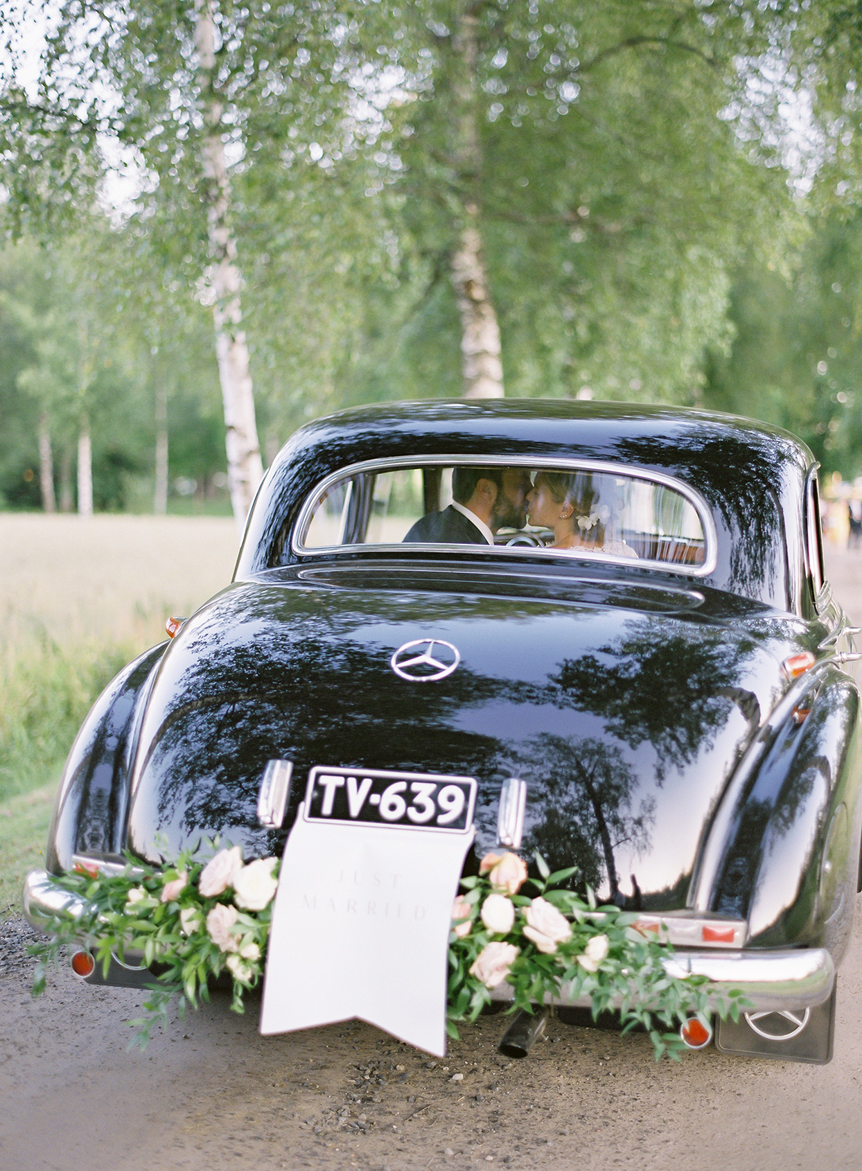 laura alexander wedding couple in car