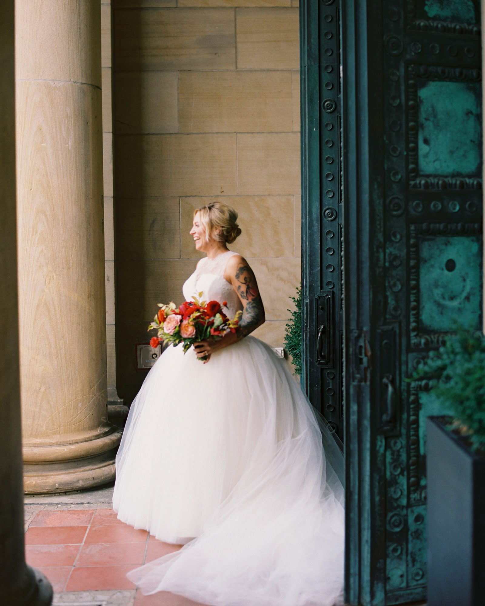 meaghan and david bride holding bouquet
