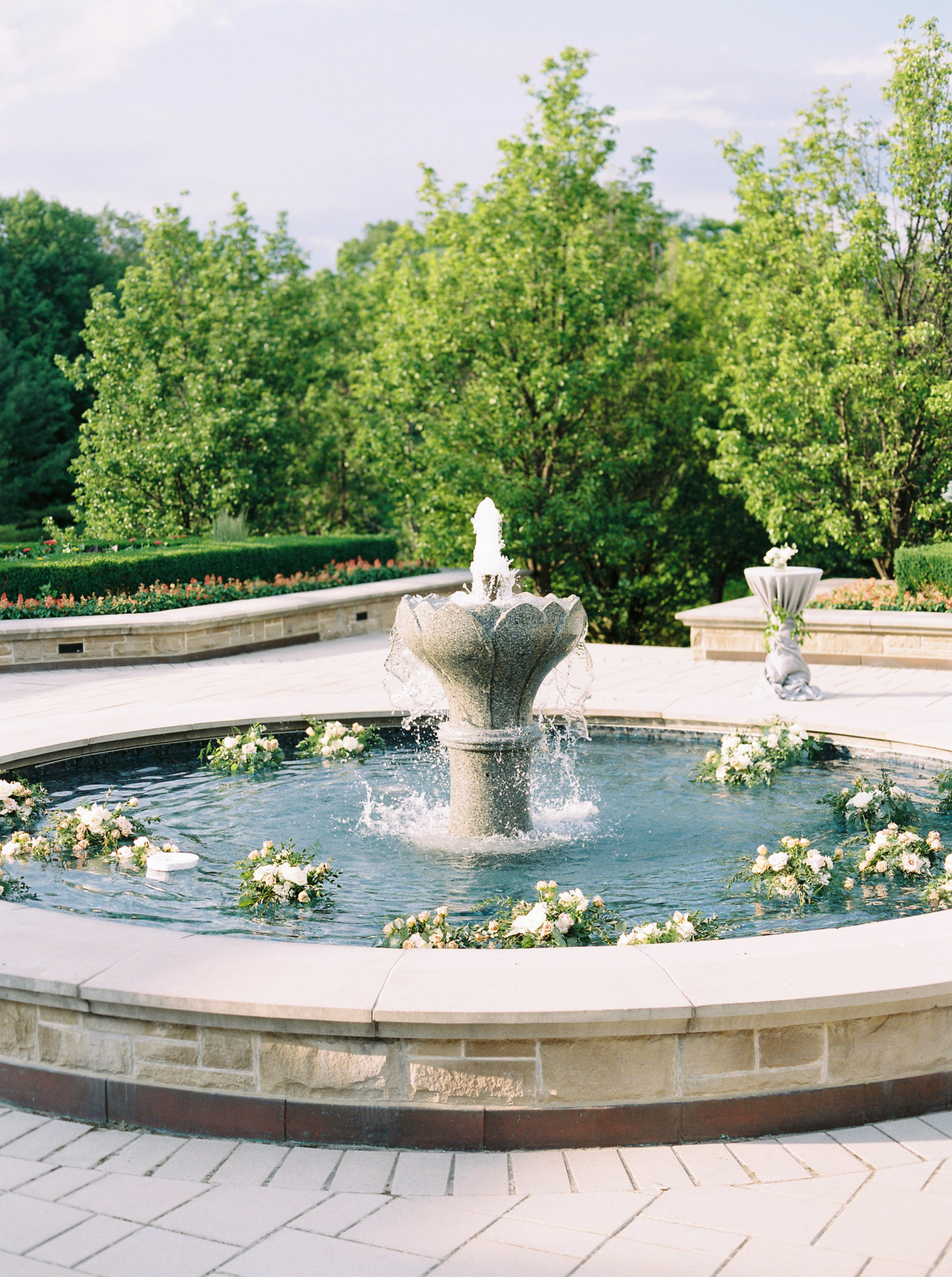 large outdoor fountain full of floating floral arrangements
