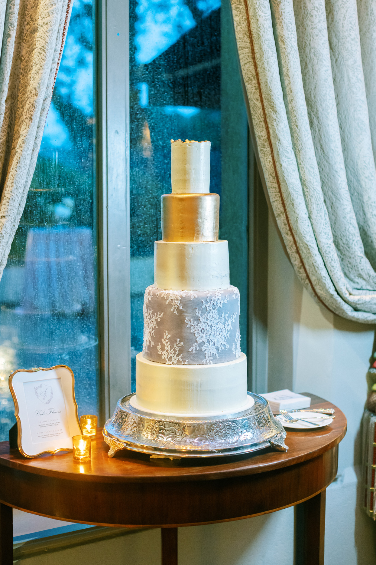 five tiered white silver and gold wedding cake