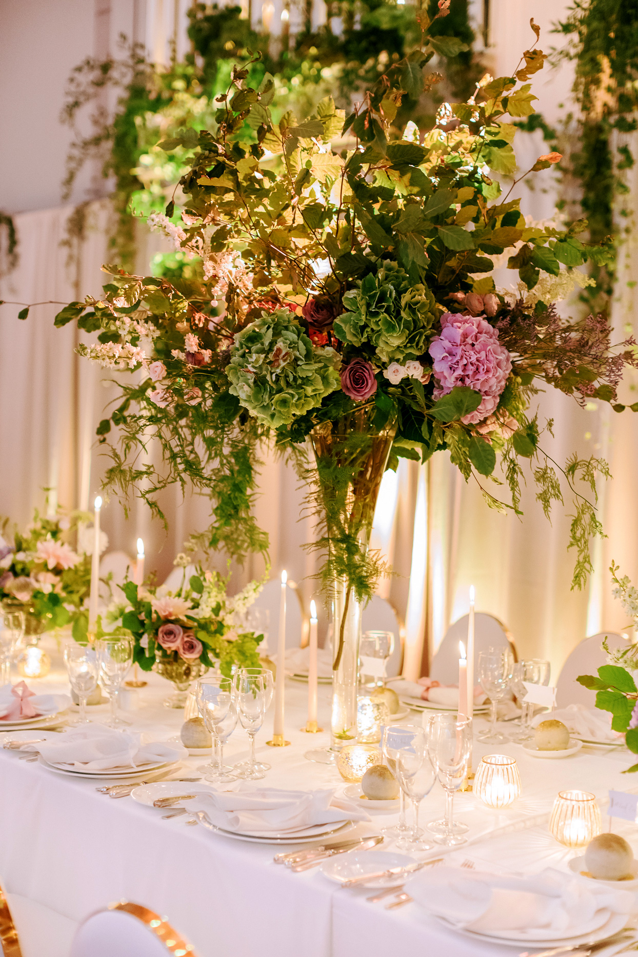 tall greenery and floral table centerpieces
