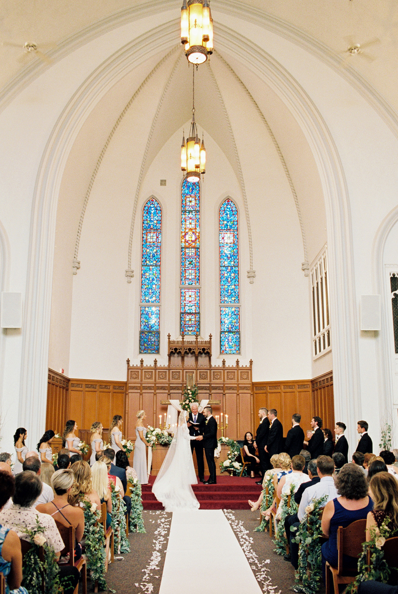 wedding ceremony indoor church alter stained glass