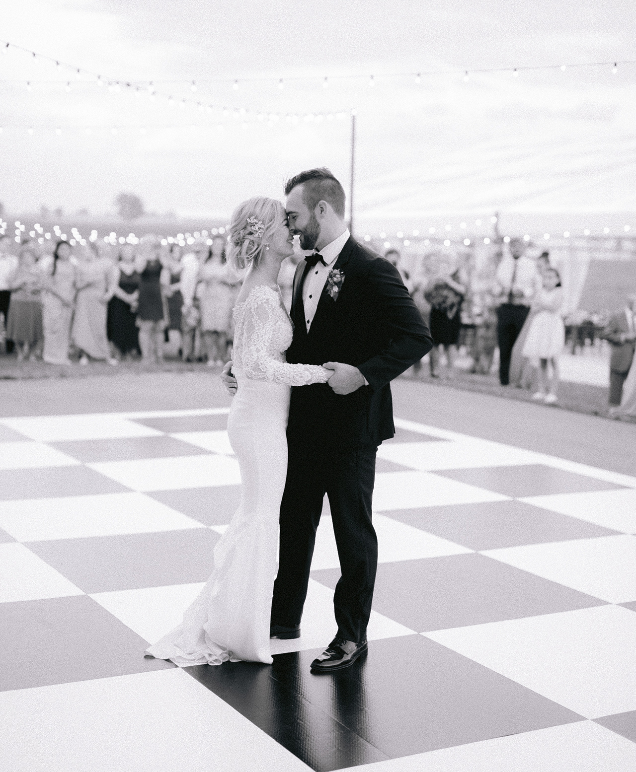 bride groom first dance checkered floor outdoors