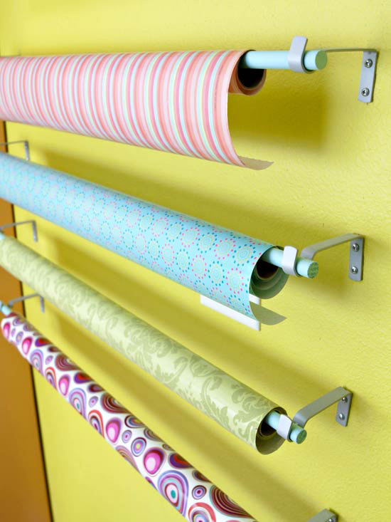 Wall mounted paper roll holders