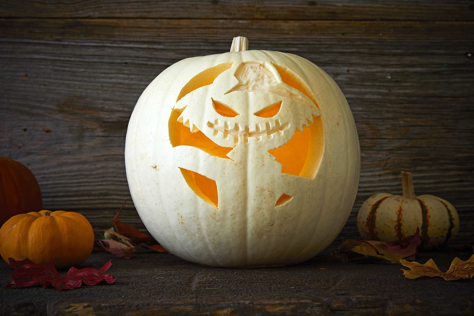 gremlin with hat carved into pumpkin