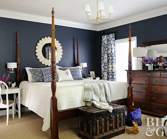 high-contrast bedroom with navy walls