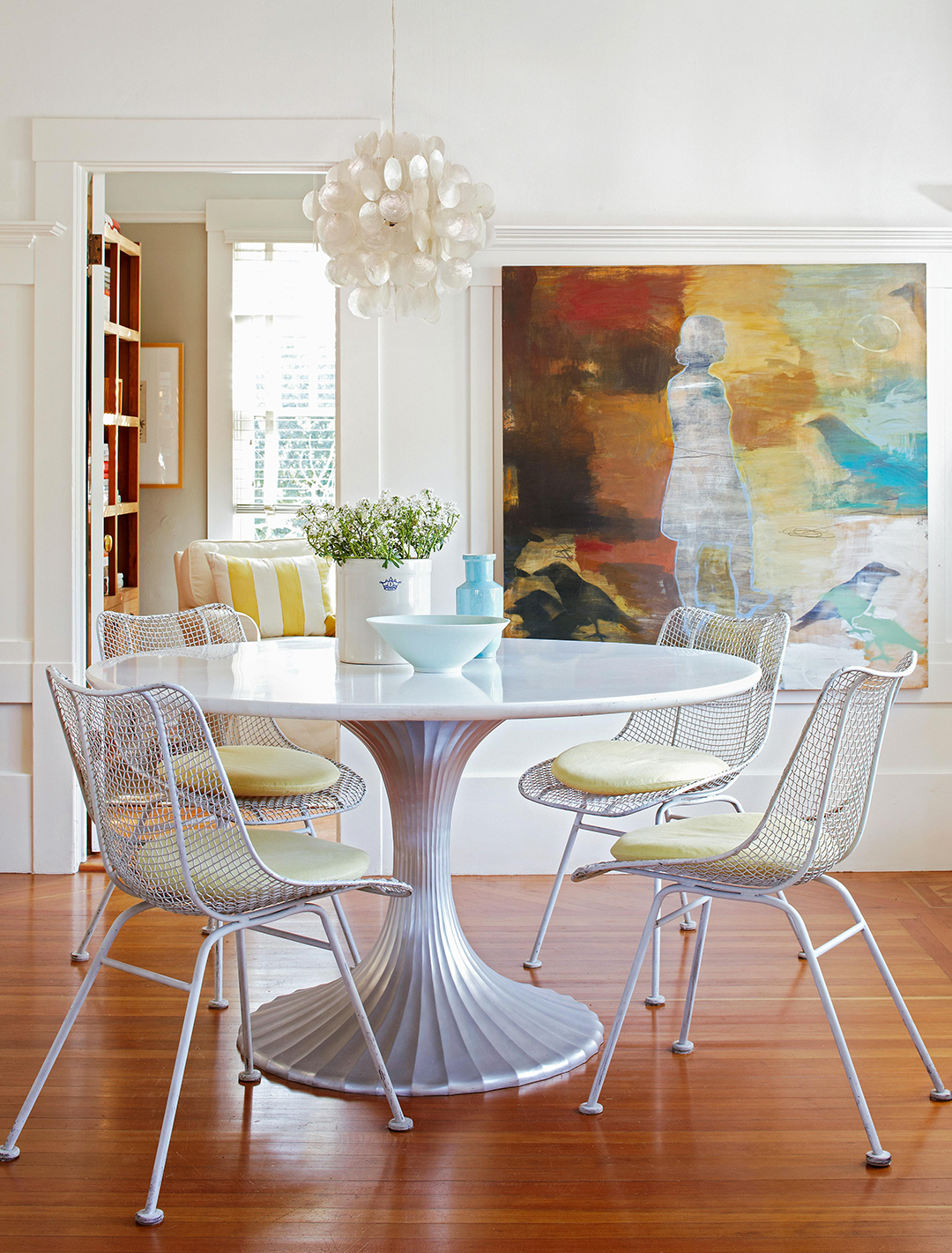 dining room with round table and art decor