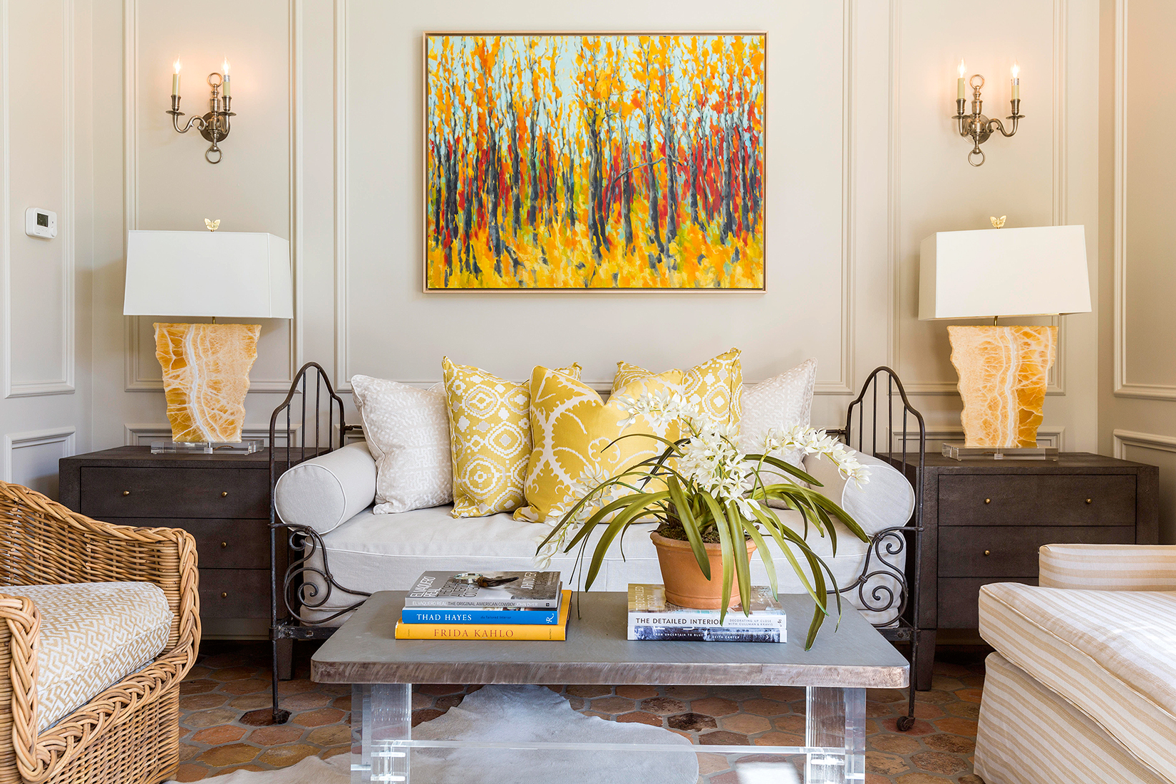 traditional living room with yellow accents and painting