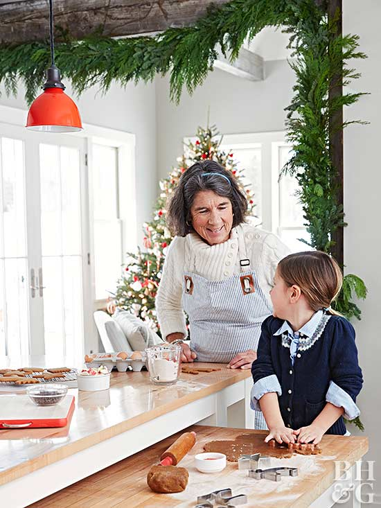 woman and child baking holiday gingerbread cookies