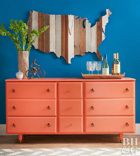 wooden silhouette map over coral dresser