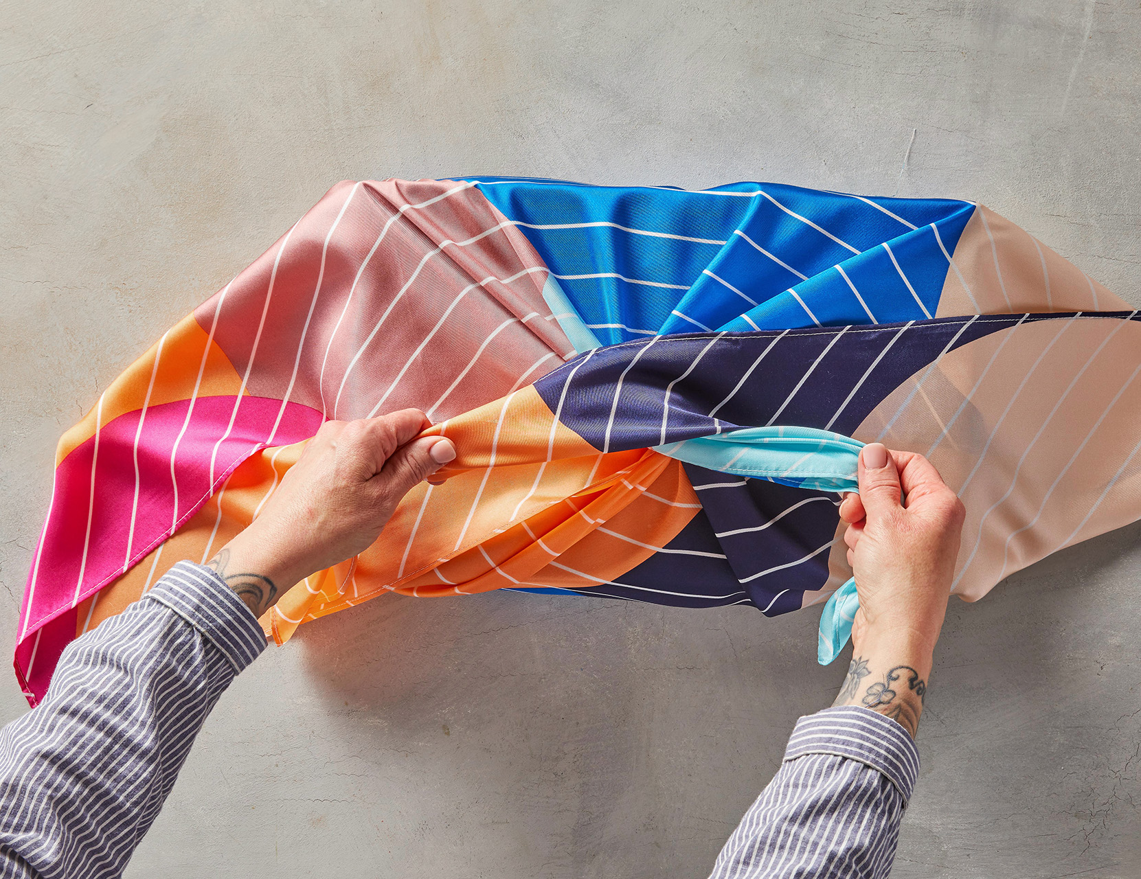 colorful scarf tied into gift wrap first knot
