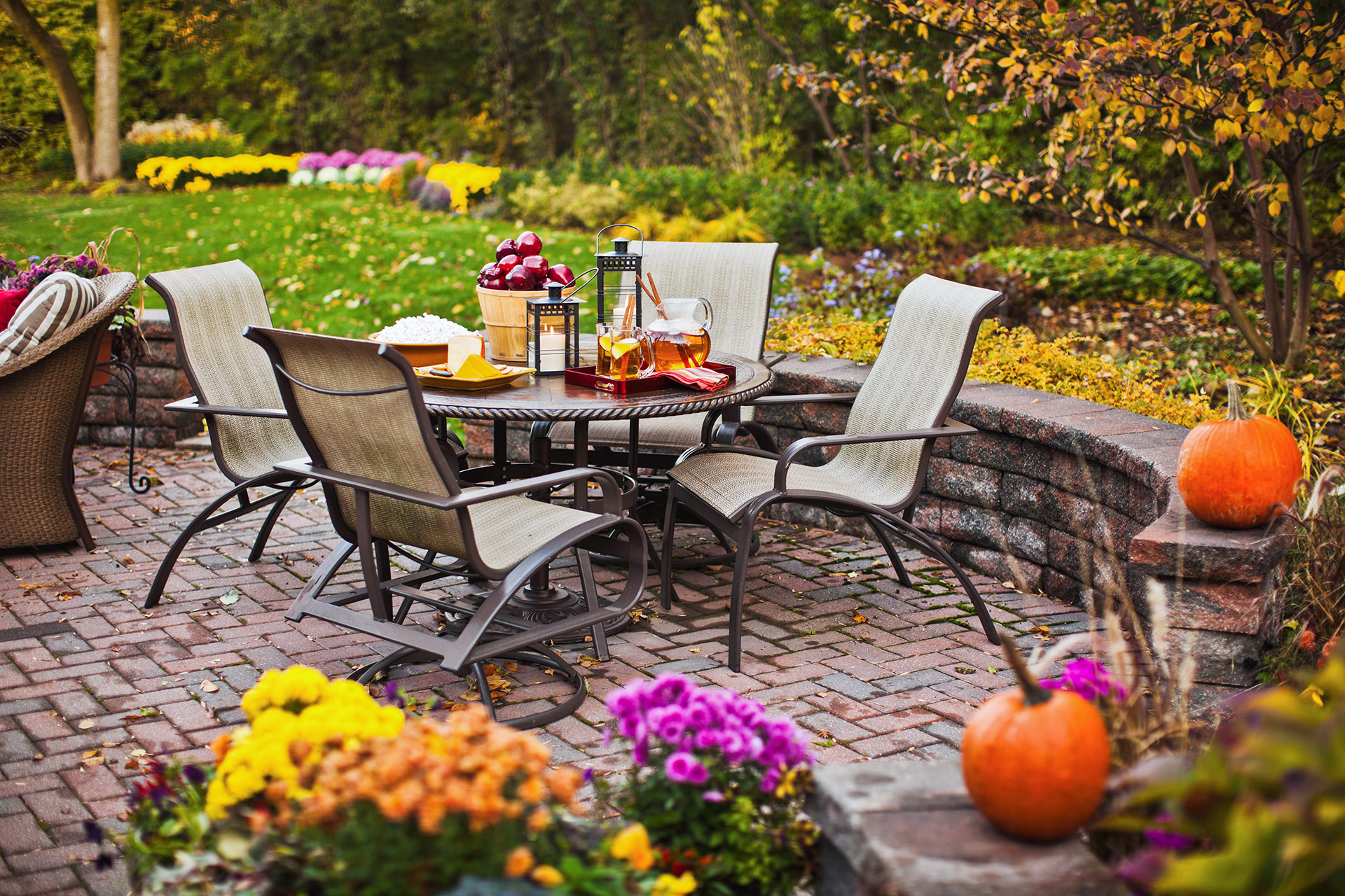 backyard brick patio with outdoor furniture fall