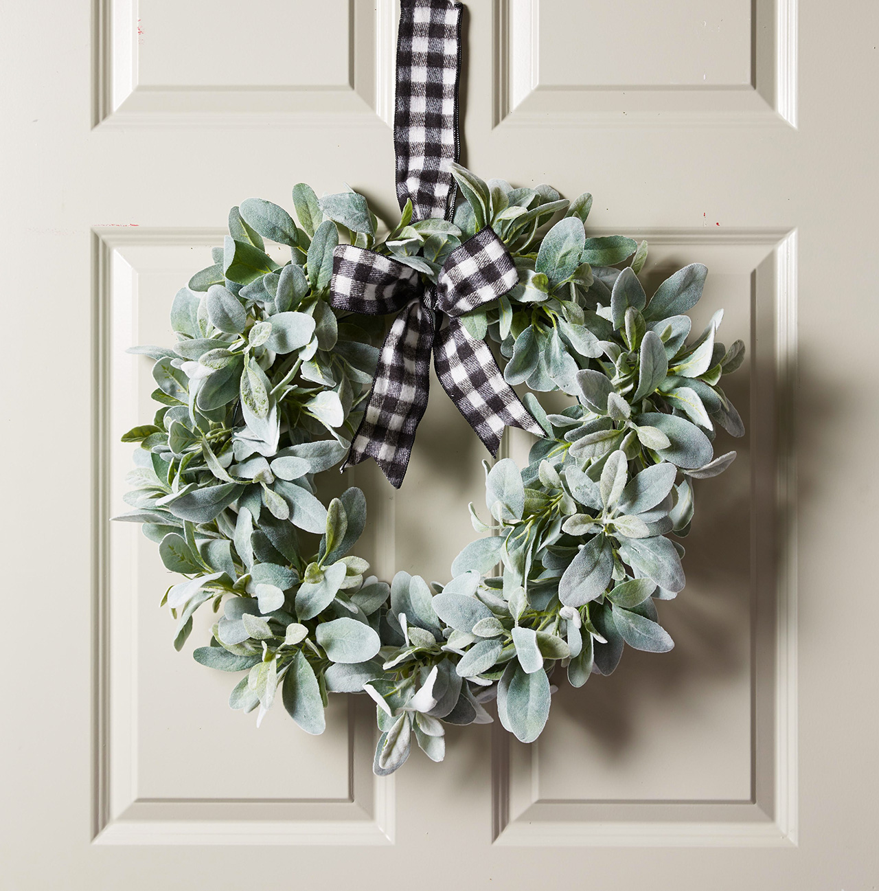 wreath with foliage and buffalo check ribbon