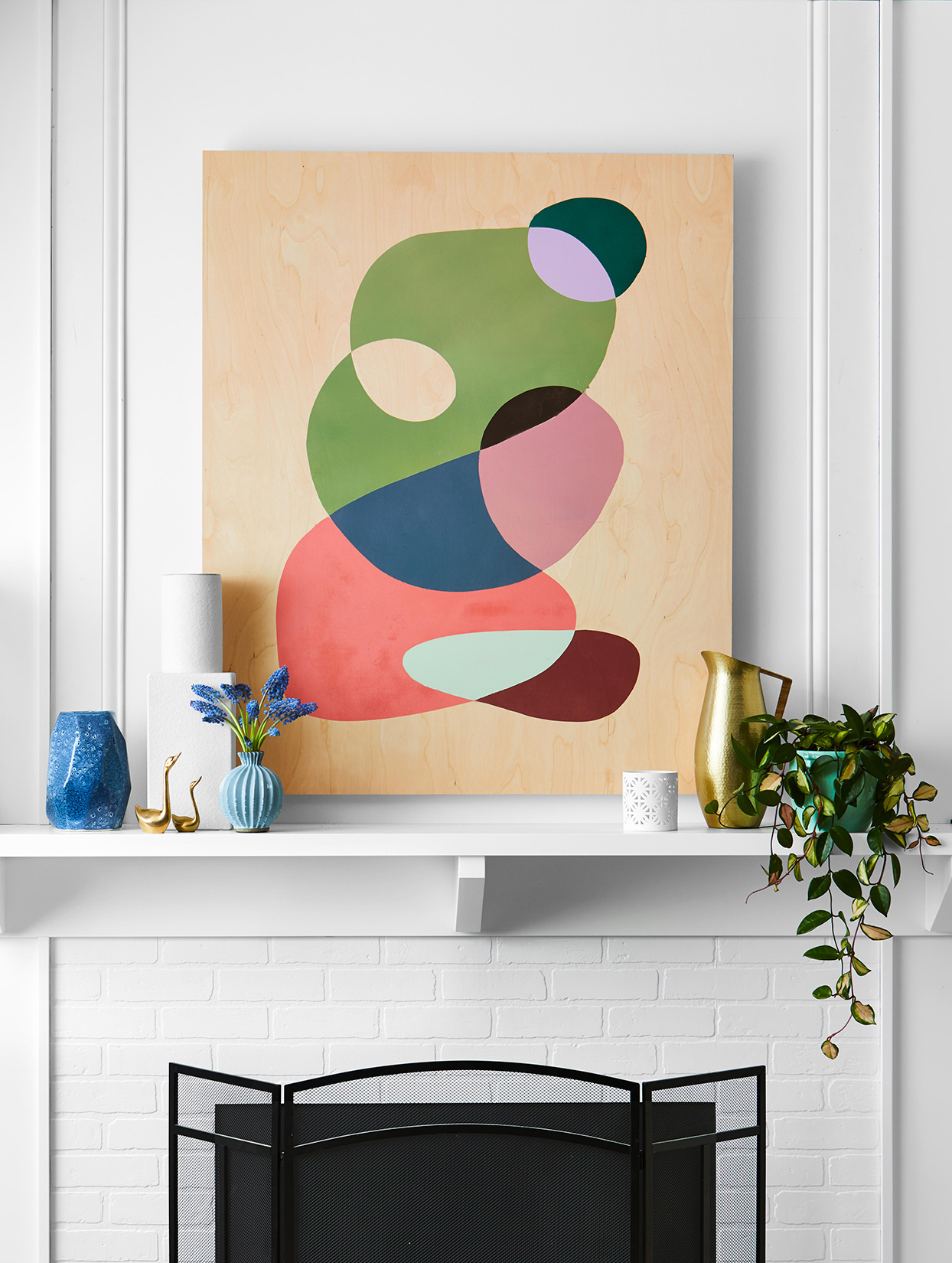 Colorful painting on mantelpiece at home