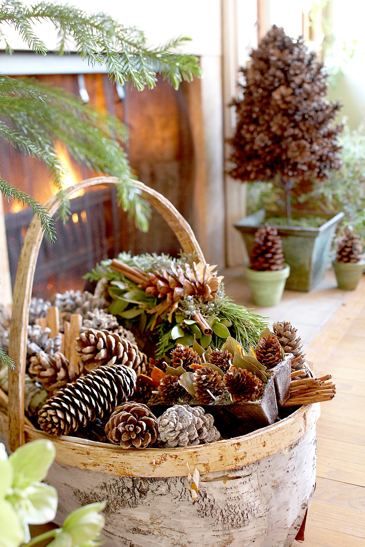 Basket near fireplace filled with pinecones