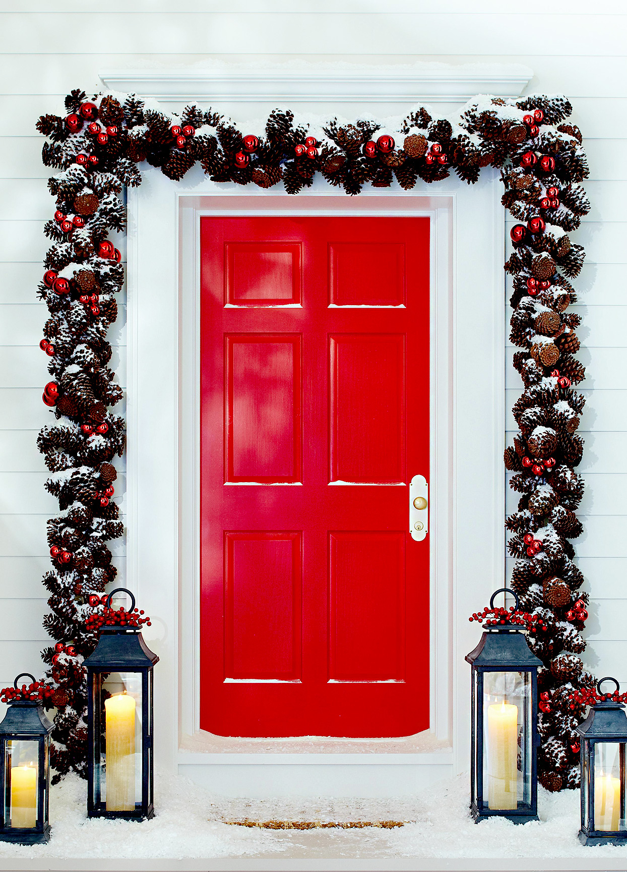 Red front door with pinecone festive pinecone décor