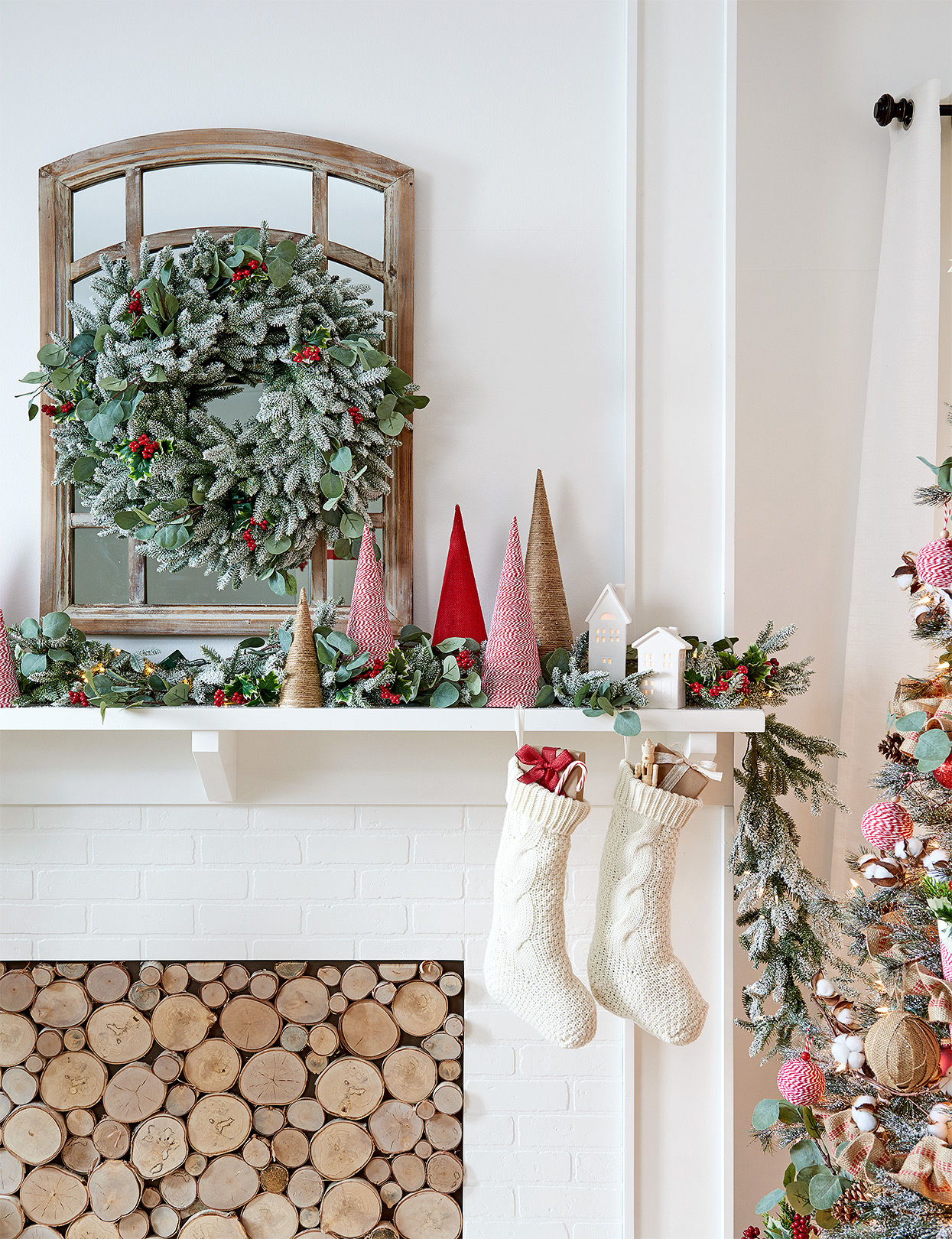 wreath above mantel with twine-wrapped cones and flocked greenery