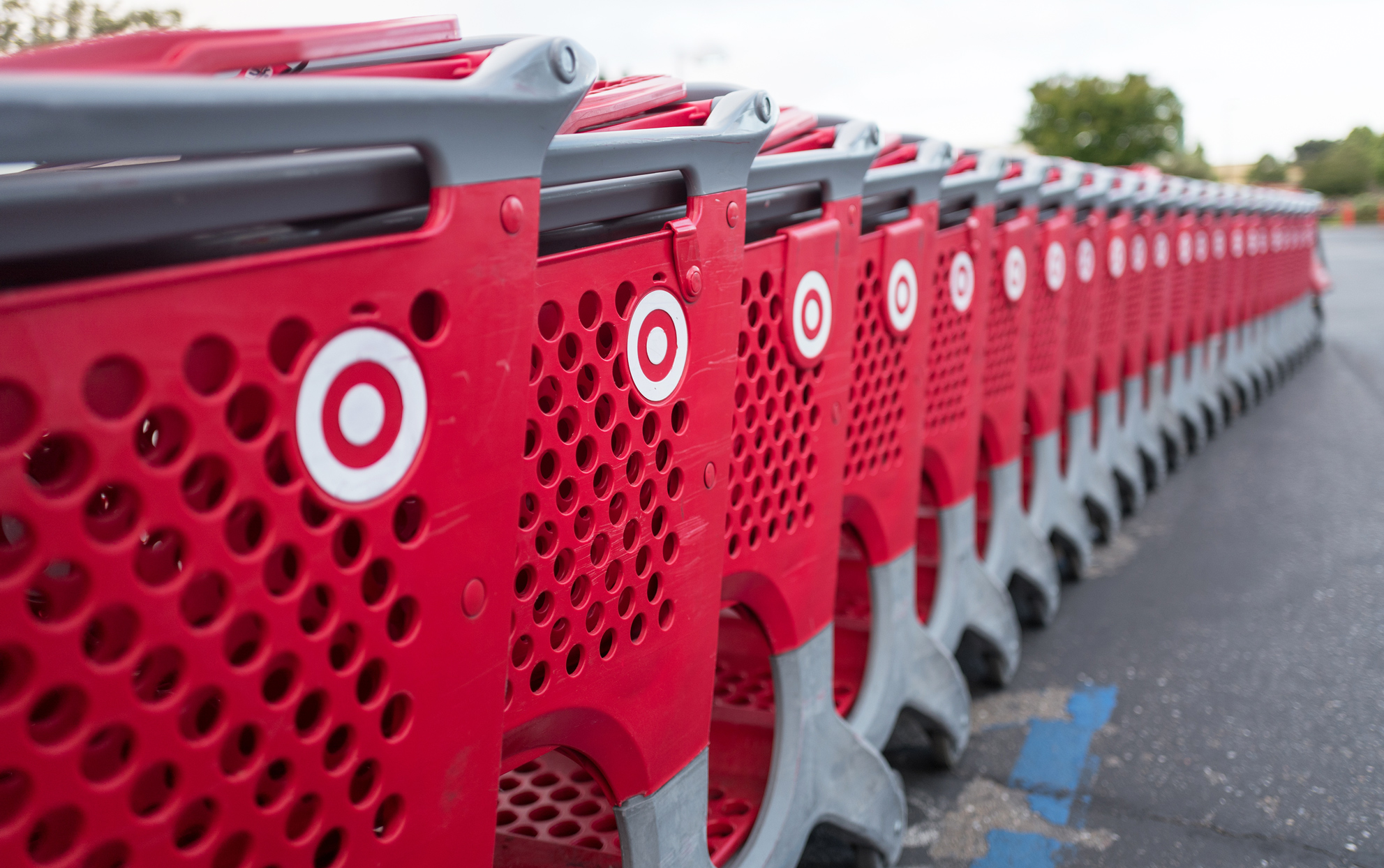 a row of Target Store shopping carts in a parking lot