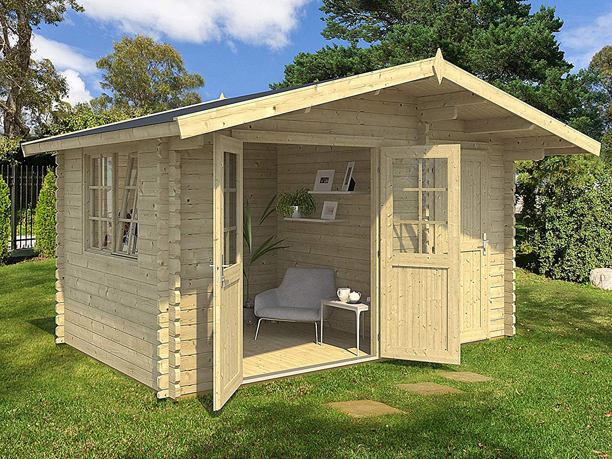 light tan tiny house with double doors open on grassy lawn