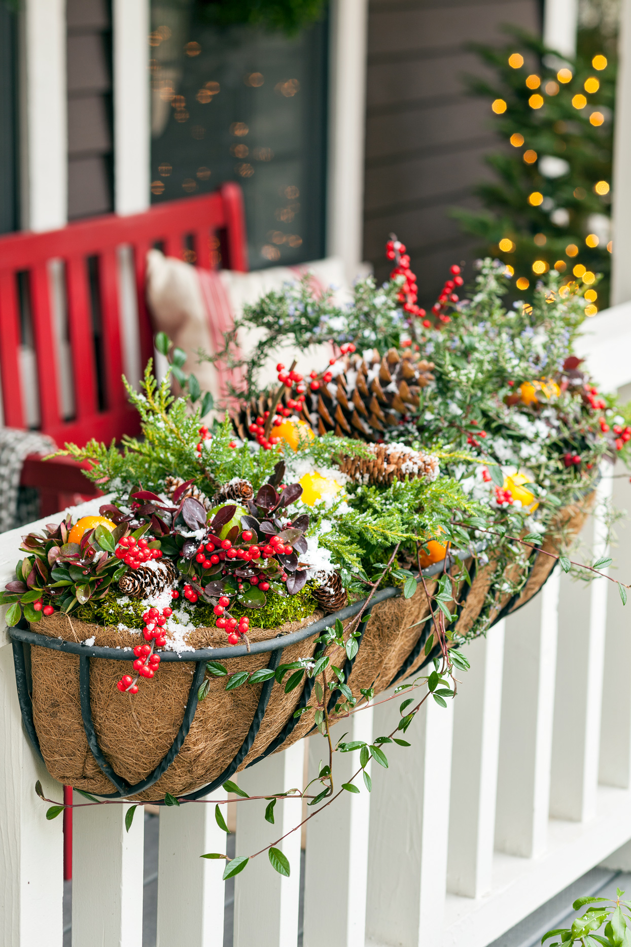 porch railing decorated with festive planter
