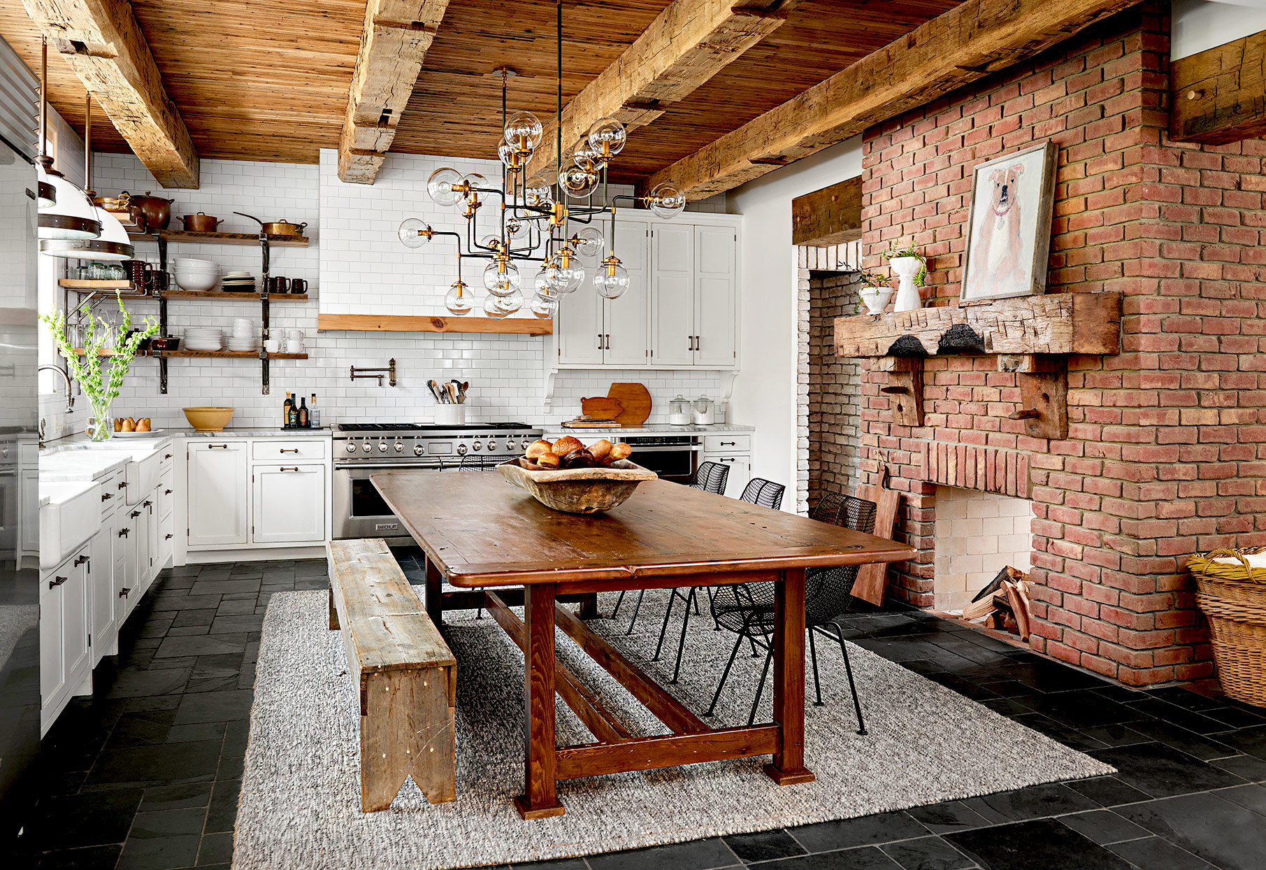Kitchen with wooden table and brick fireplace