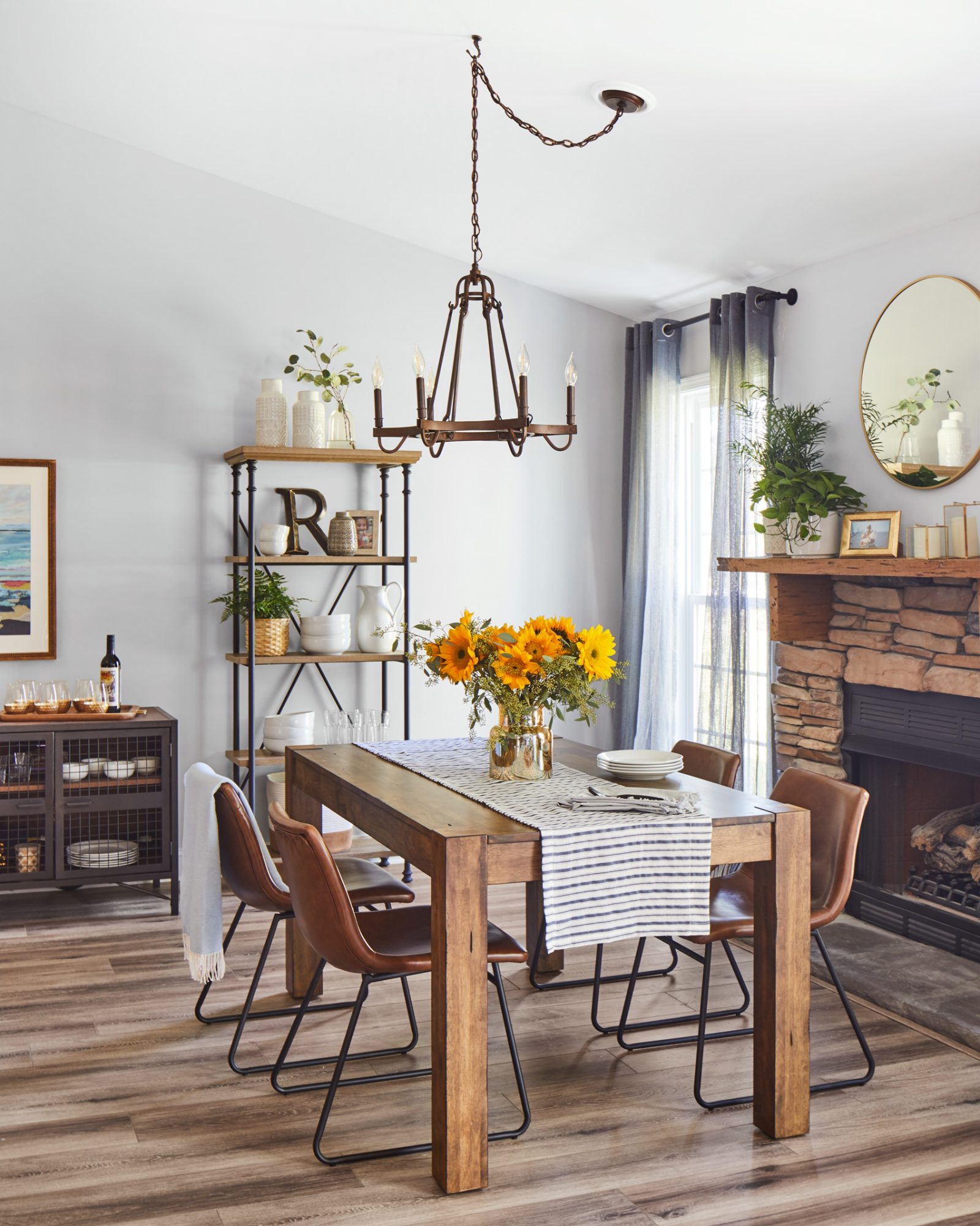 white dining room with wood table and floor