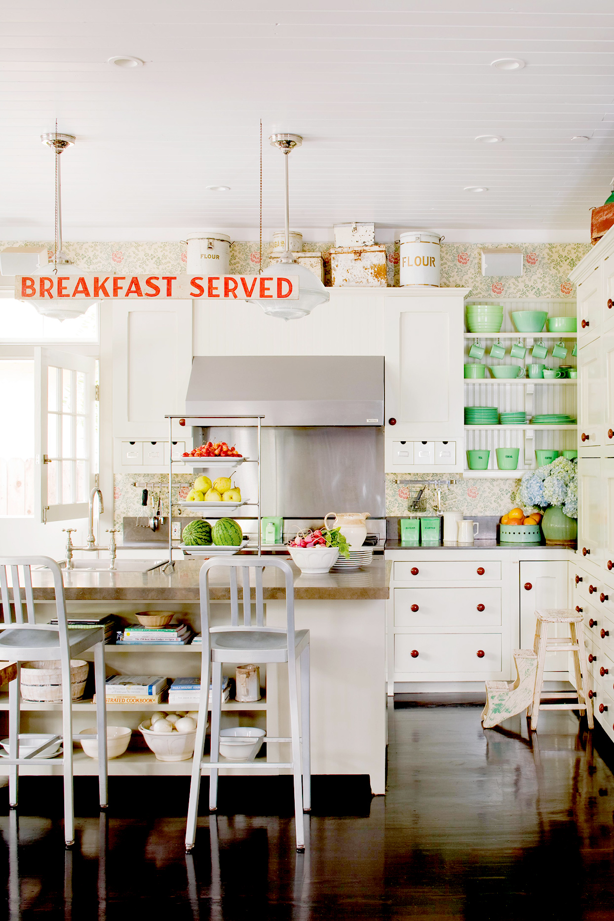 "White and green kitchen with sign that says ""Breakfast Served"""