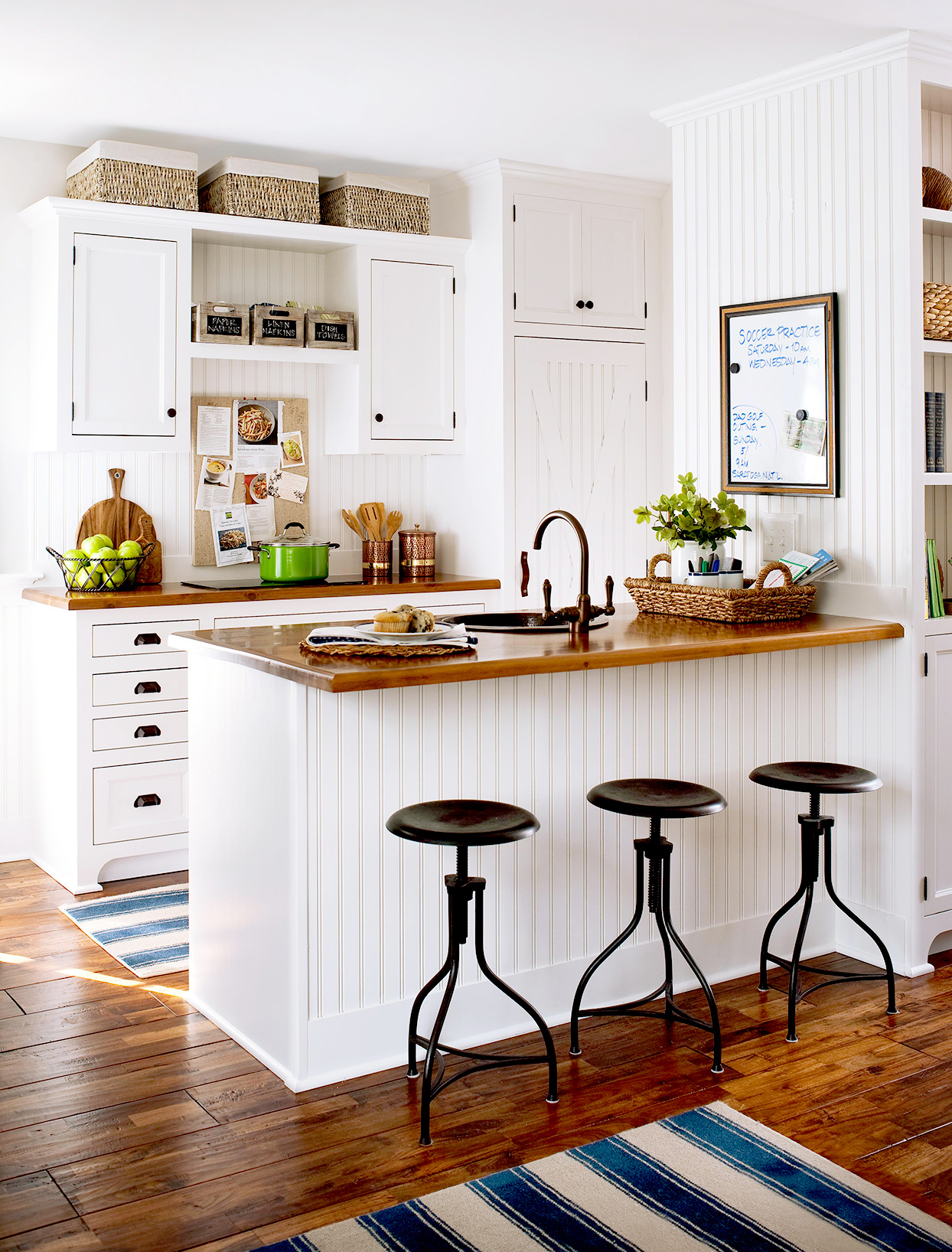White kitchen with bar seating and stools