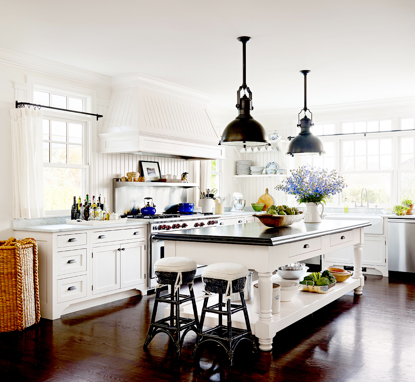 White kitchen with island and wooden tops