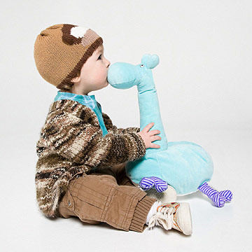 baby sitting and kissing toy