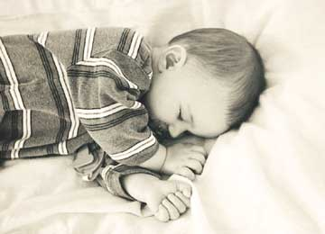 Baby Sleeping in Striped Pajamas in Black and White