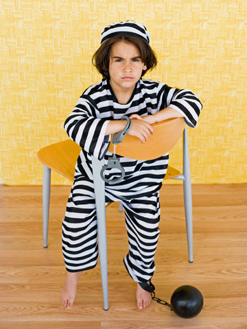 Boy in a prison outfit