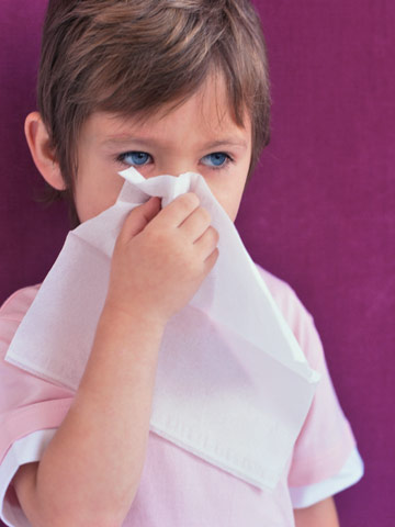 Child holding a tissue
