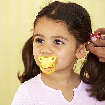 toddler with a pacifier