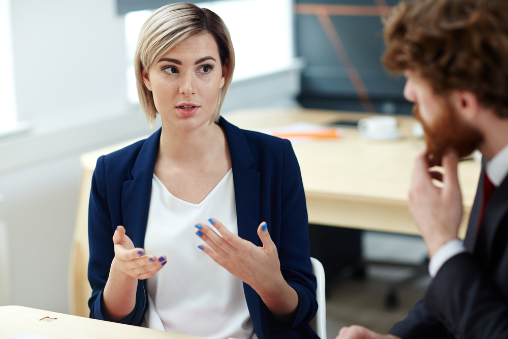 Woman Talking to Boss at Work