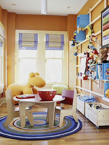 Play room with round blue white rug