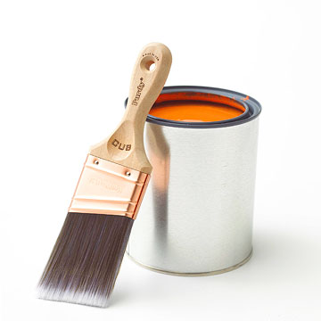 paint brush against paint can