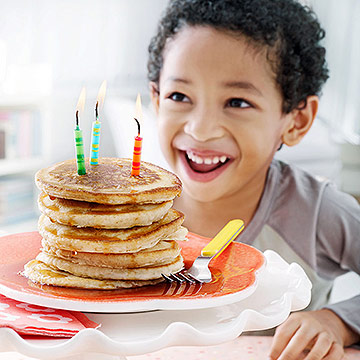 stack of pancakes with birthday candles