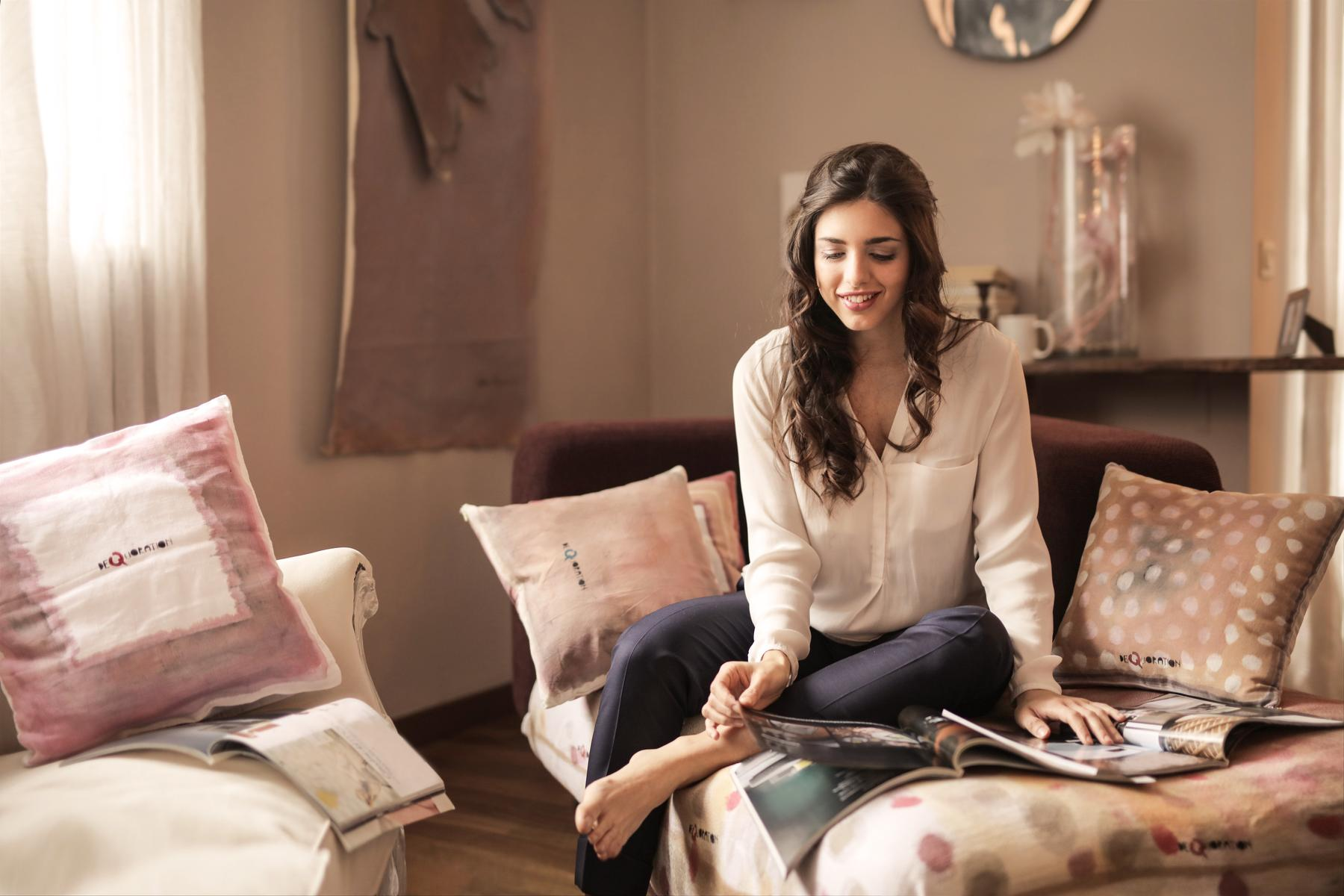 Woman Relaxing Reading Magazines on Couch