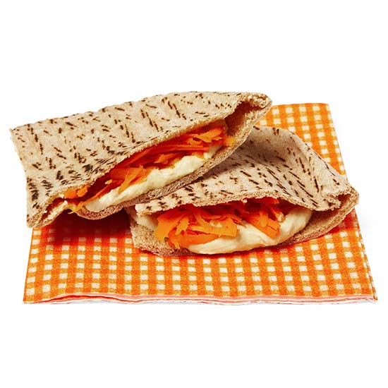 Whole-grain pitas with hummus and shredded carrots