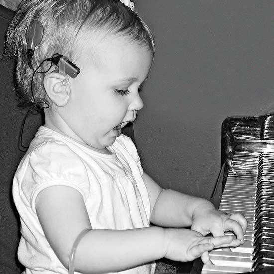 "At 16 months, she played the piano and ""sang."""