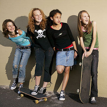 girls hanging out with skateboards