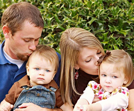 Two-year-old Mecaden with Todd, Emily, and brother Levi