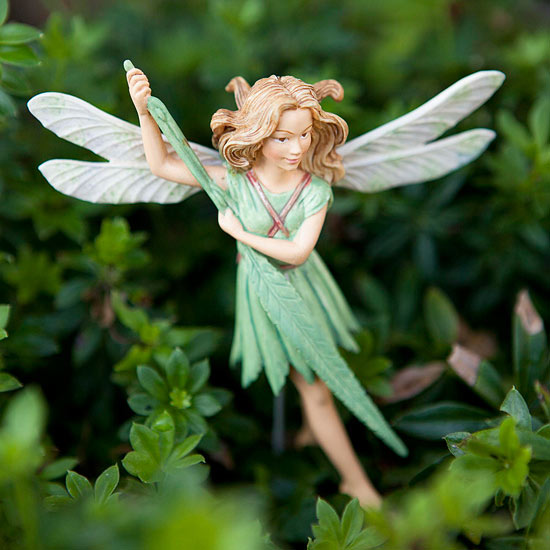 fairy ornaments in garden